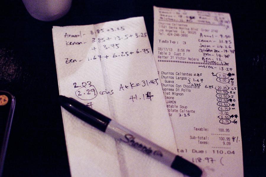 Tallying the bill at Churros Calientes.
