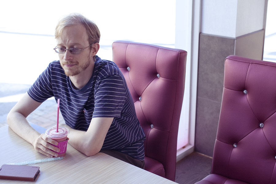 Ottie nursing his strawberry drink at Baskin Robbins in Sangju, South Korea.