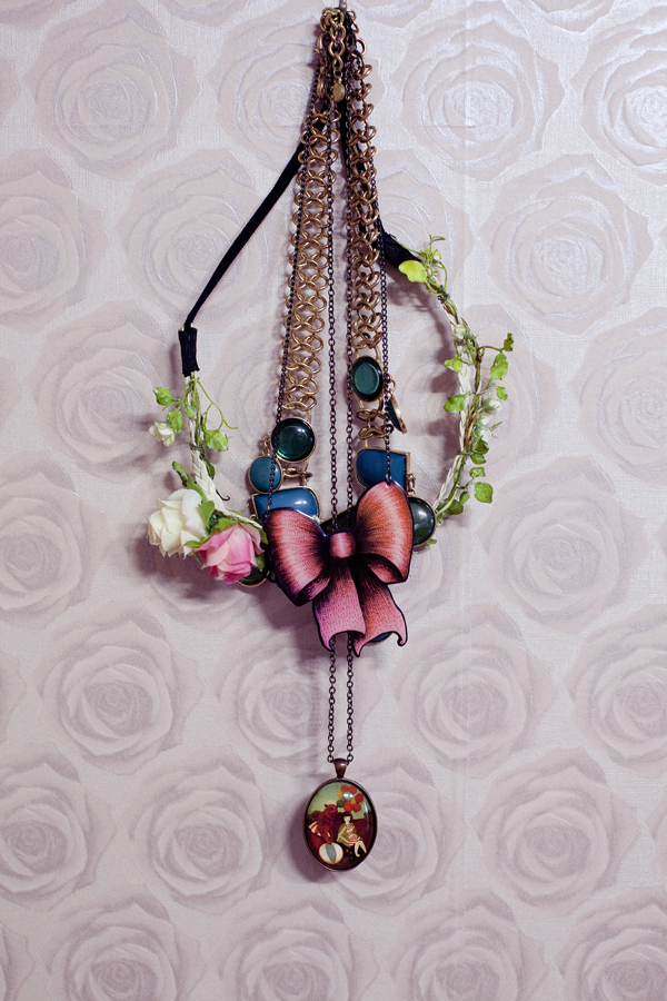 Accessories, jewelry, and necklaces on the wall.