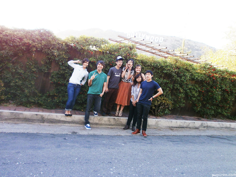 Friends in front of the Hollywood sign in Los Angeles.