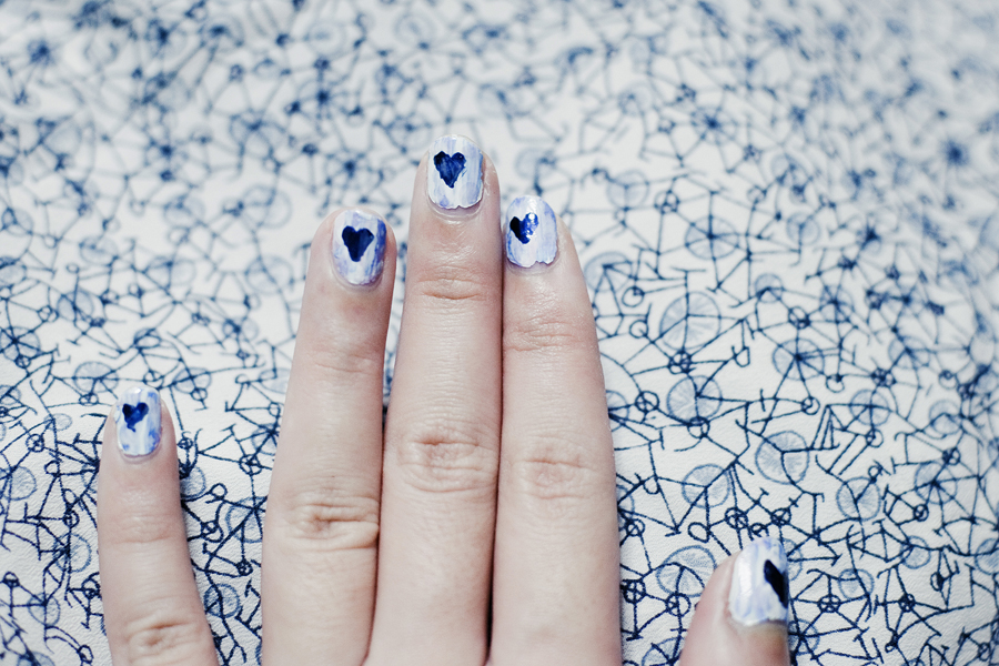Hearts on my blue nails.