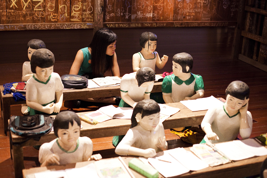 Ruru at The Sick Classroom by Nge Lay. 27 wooden sculptures and classroom furniture.