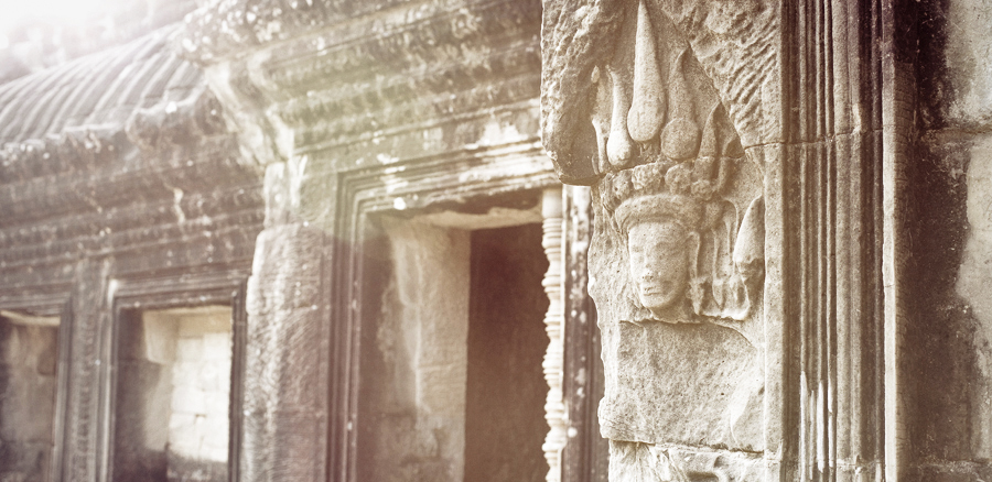 Morning sun against a bas-relief of an apsara at Angkor Wat, Cambodia.