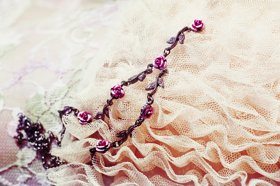 Close-up of Paris Kids dark rose necklace.