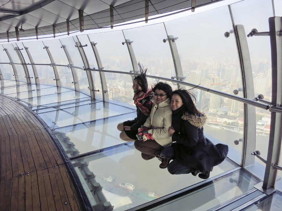 The three of us on the glass floor of the sightseeing corridor of the Oriental Pearl, Shanghai. Photo from Ade.