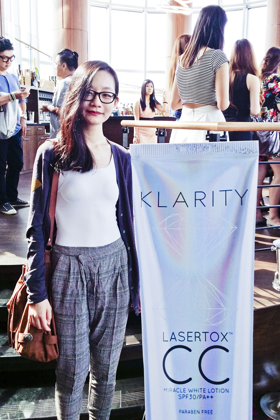 Ren posing with the Klarity CC cream cut-out at the Klarity Beauty Brunch event.