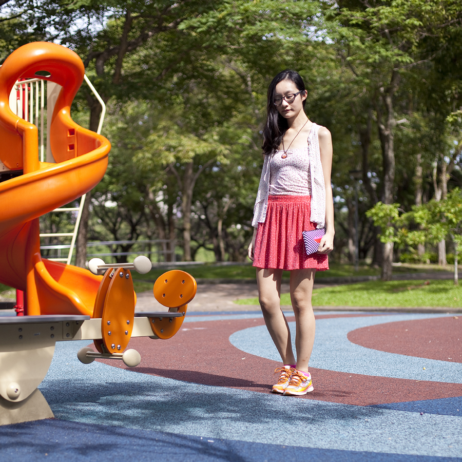 Outfit of the Day (#ootd) at a playground: Gap glasses, Paper Sparrow narwhal necklace, Uniqlo floral bratop, Forever 21 polka dot chiffon top, Zara polka dot skirt, Espirit hot pink socks, Sketchers neon sneakers, Sephora striped purse.