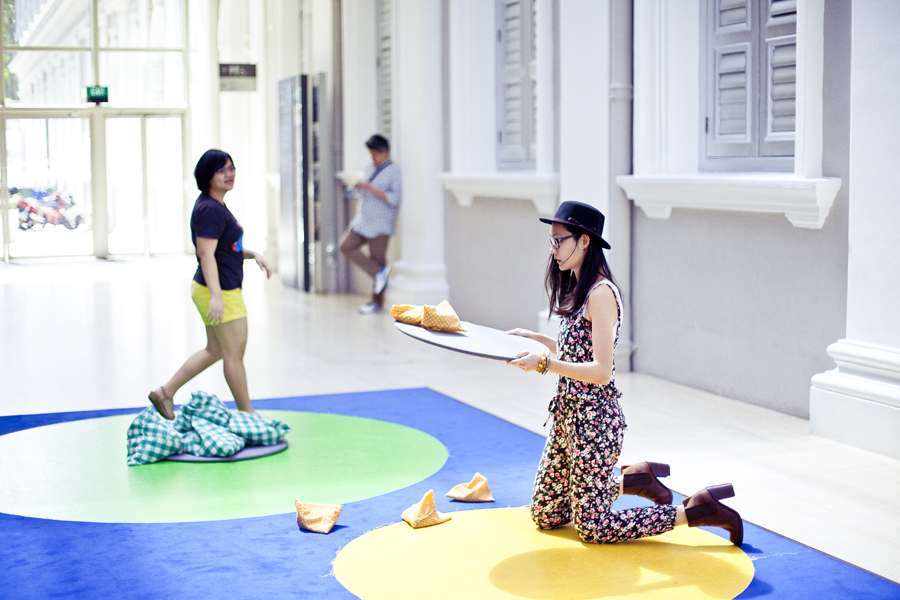 Playing with a contemporary interactive take on the traditional five stones game at the Masak Masak exhibit at the National Museum of Singapore. Photo by Ade.