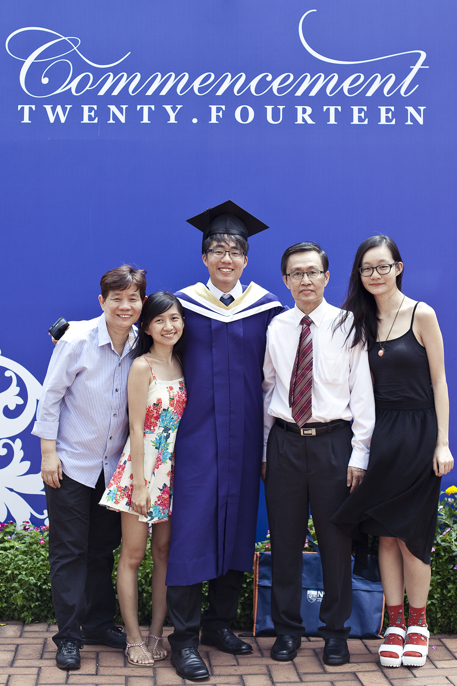 Ren and family at the NUS Commencement 2014.