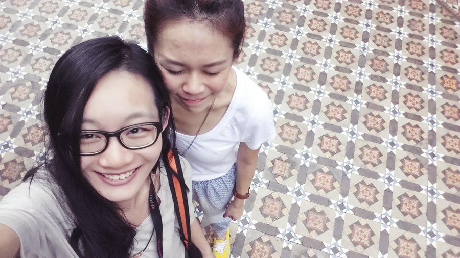 Ren and Krys against the pretty tiled floor of Thian Hock Keng temple, Singapore,