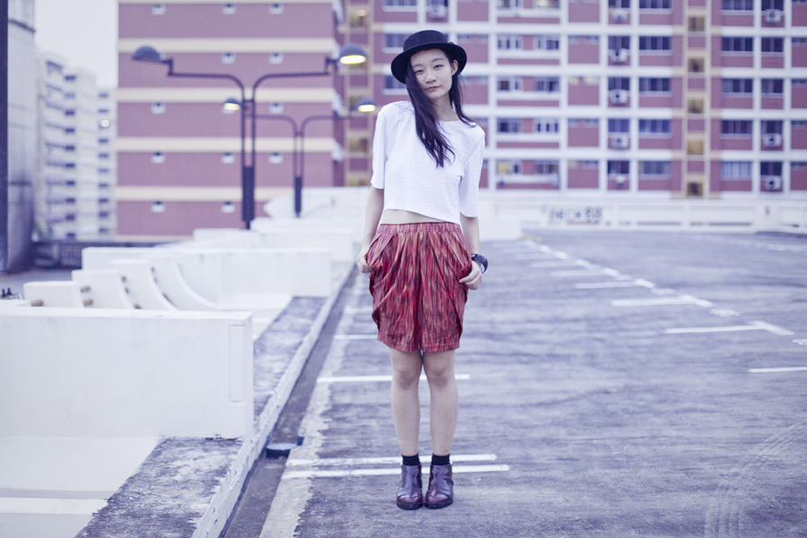 Outfit wearing white textured crop top from Bec & Bridge via Shopbop, Club Marc snakeskin print skirt, Jeffrey Campbell cutout booties in wine via Shopbop, black felt hat from Taobao, black socks from Taobao, canvas pouch from Innisfree.