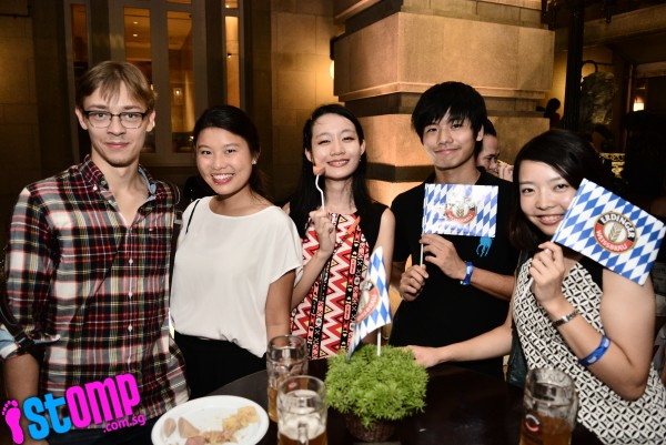 Photo of Deb and Ren and partygoers at Oktoberfest Singapore Fullerton Hotel. Photo by Stomp.