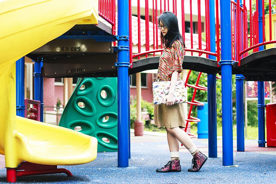Red striped knit sweater, Zara tan tie skirt, pijama jurassic laptop sleeve c/o East Dane, Happy Socks c/o East Dane, Puma x McQ high top sneakers c/o Shopbop, Gap black frame glasses.