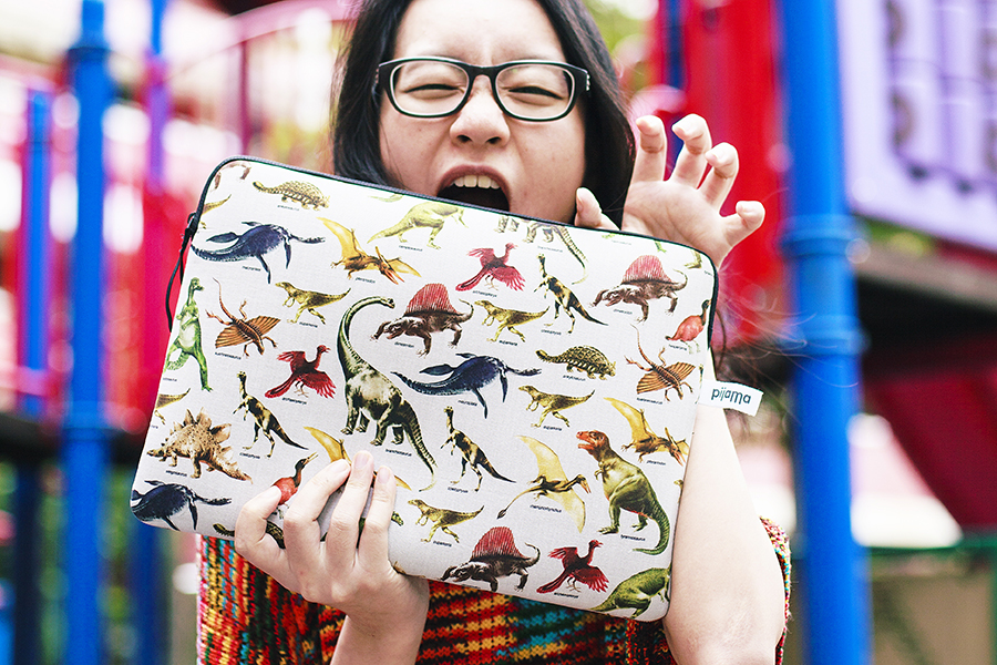 Red striped knit sweater, pijama jurassic laptop sleeve c/o East Dane, Gap black frame glasses.