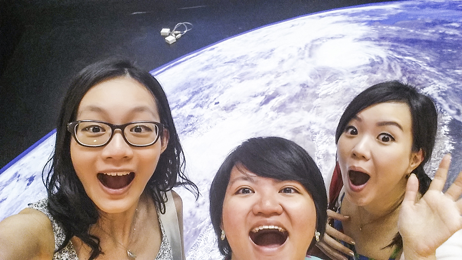 Wefie with Puey and Ade with planet earth from outer space.