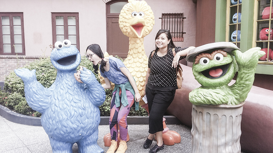 Posing with Sesame Street characters at Universal Studios Singapore.