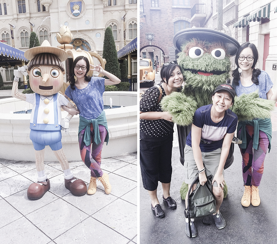 Posing with characters Pinocchio from Shrek and Oscar from Sesame Street at Universal Studios Singapore.