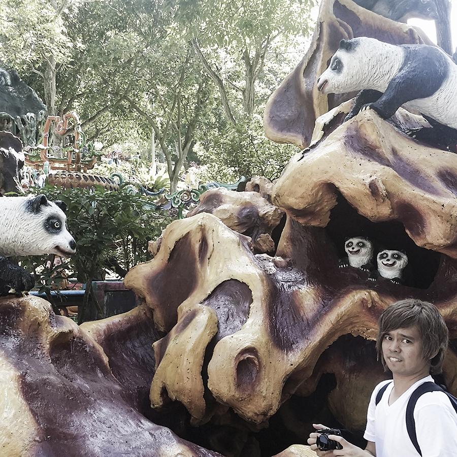 Shamis at the statues of scary pandas at Haw Par Villa, Singapore.