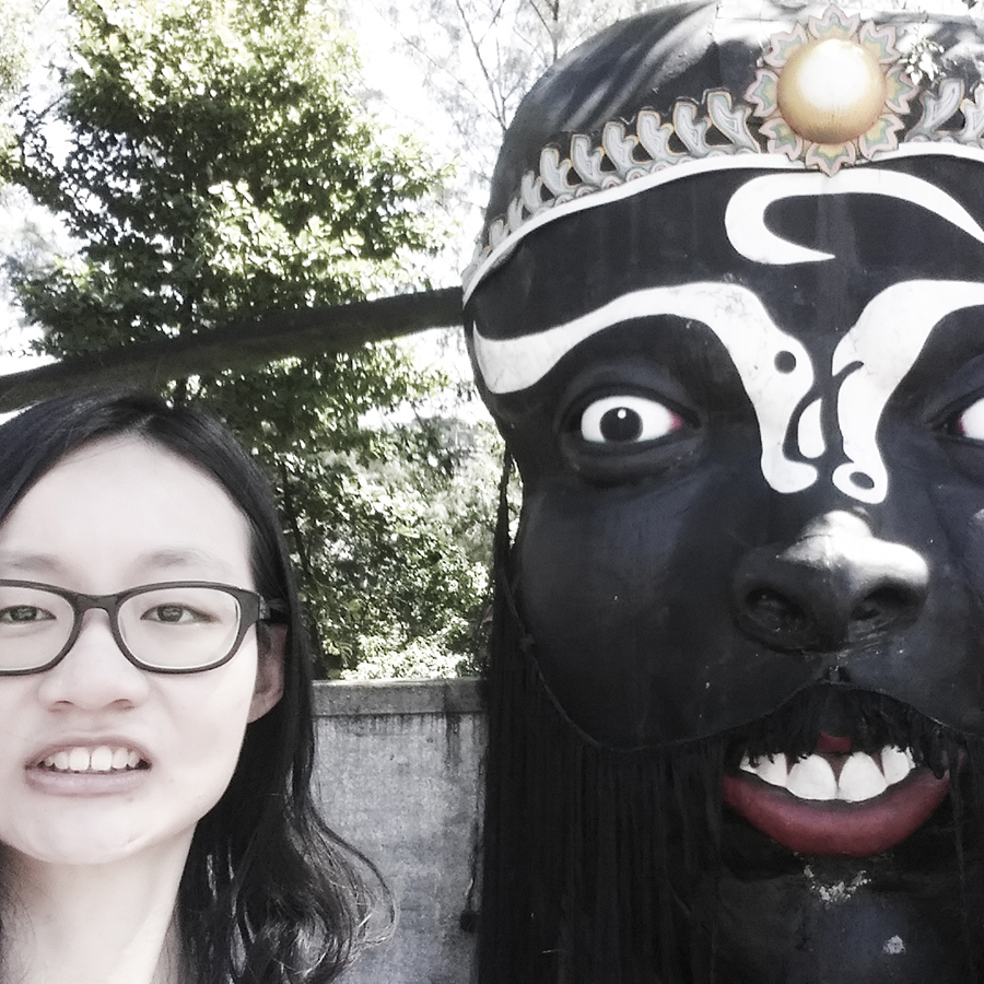 Selfie with scary giant mask statue at Haw Par Villa, Singapore.