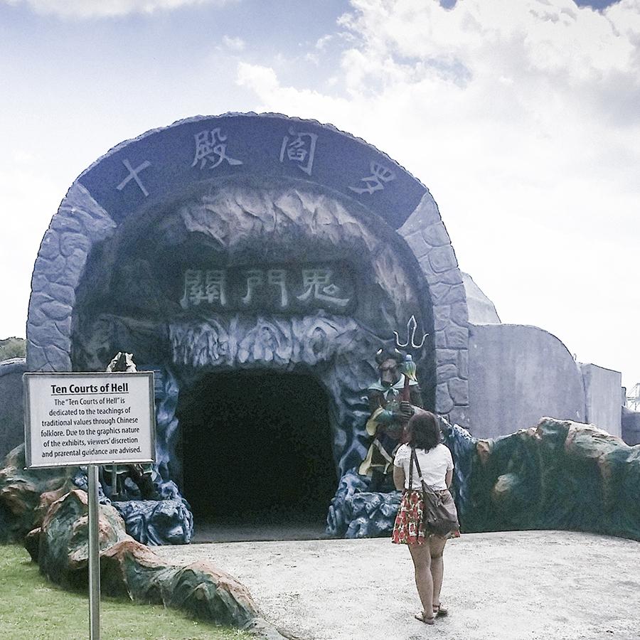 Jesca entering the Ten Courts of Hell (十八晨地狱) at Haw Par Villa, Singapore.