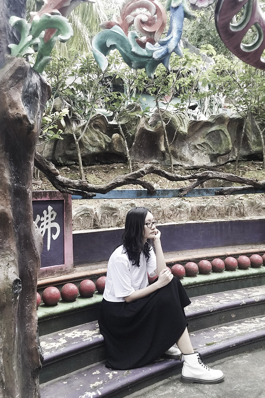 OOTD at Haw Par Villa, Singapore. Wearing white textured crop top from Bec & Bridge, black midi skirt from Lowry's Farm, white 1460 8-eye boots from Dr. Martens, black frame glasses from Gap.