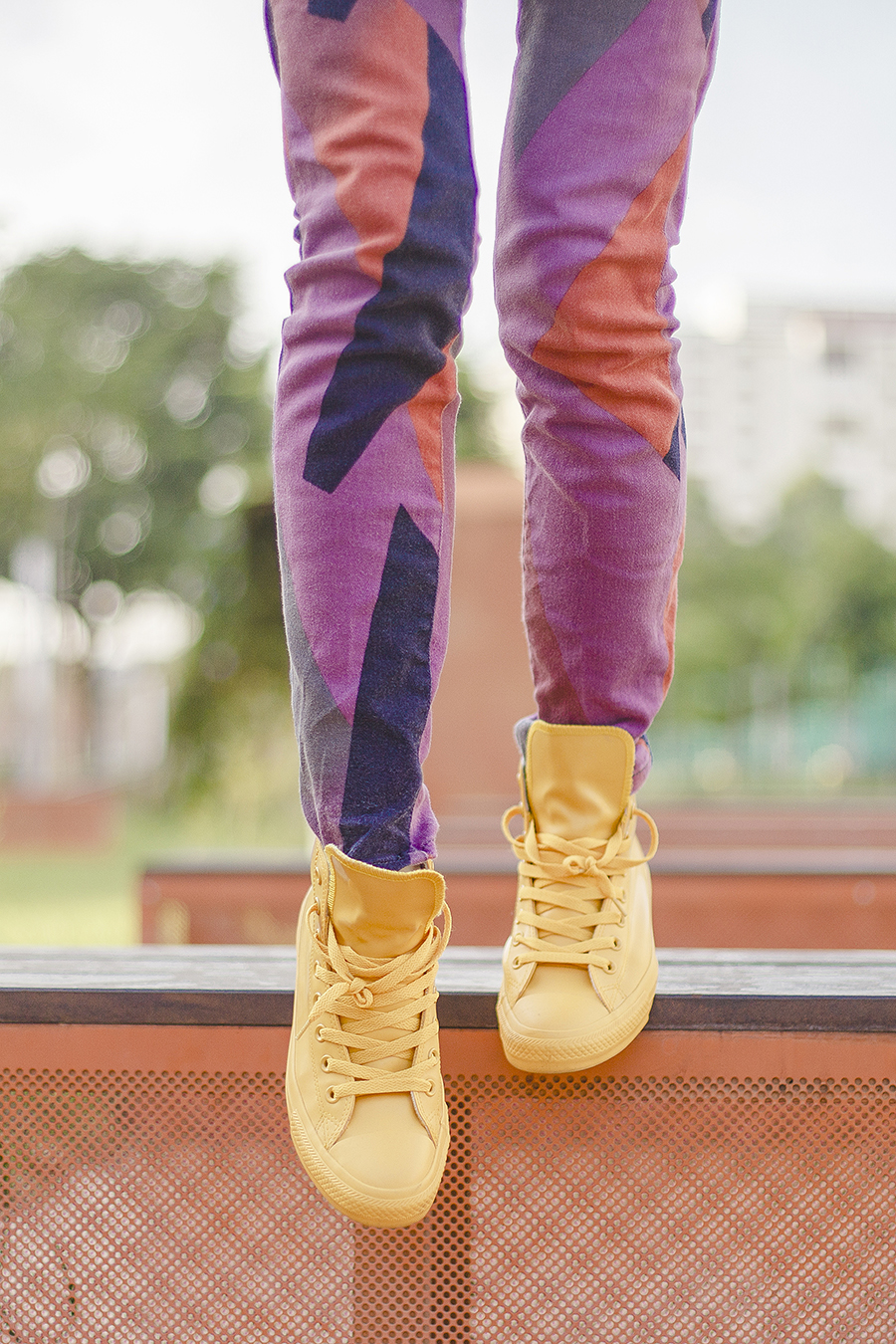 BDG abstract purple jeans from Urban Outfitters, Converse yellow rubber-coated All Stars Chuck Taylors sneakers c/o Shopbop.