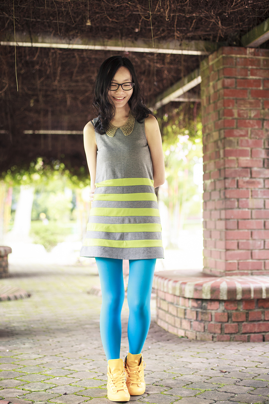 Outfit: green striped grey dress by bYSI, turquoise tights from online,yellow rubber coated all star chuck taylor sneakers from Converse c/o Shopbop, black frame glasses from Gap, gold chain collar necklace from Forever 21.
