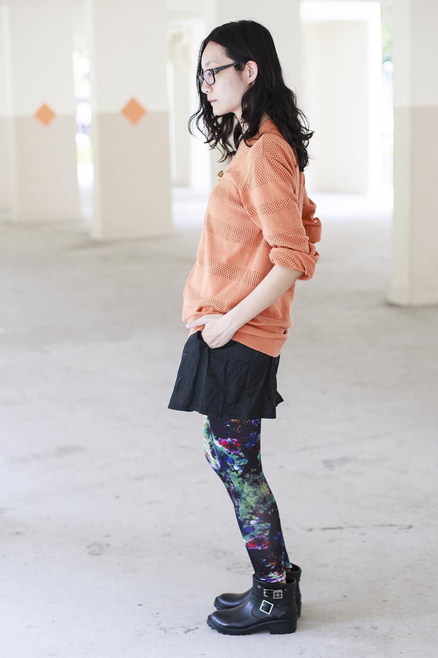 Gap black frame glasses, Forever 21 orange oversized boyfriend cardigan, vintage gold rose brooch, H&M printed leggings and Dav black rain booties c/o Shopbop, M)phosis black metallic skirt.