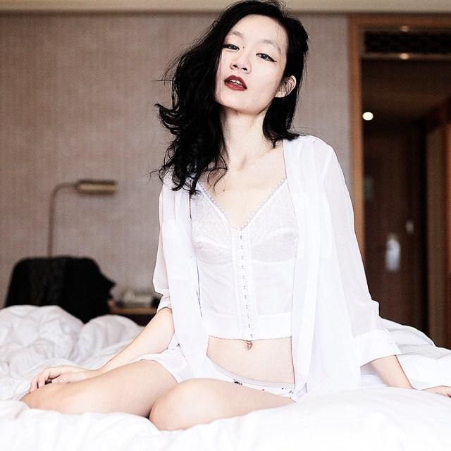 Vedette Shapewear white lace corset, M)phosis sheer white blouse.
