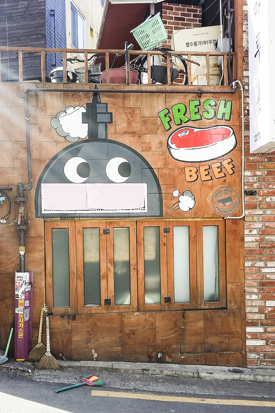 Robot mural on a shop facade at Zaemiro Seoul Comics Road, South Korea.