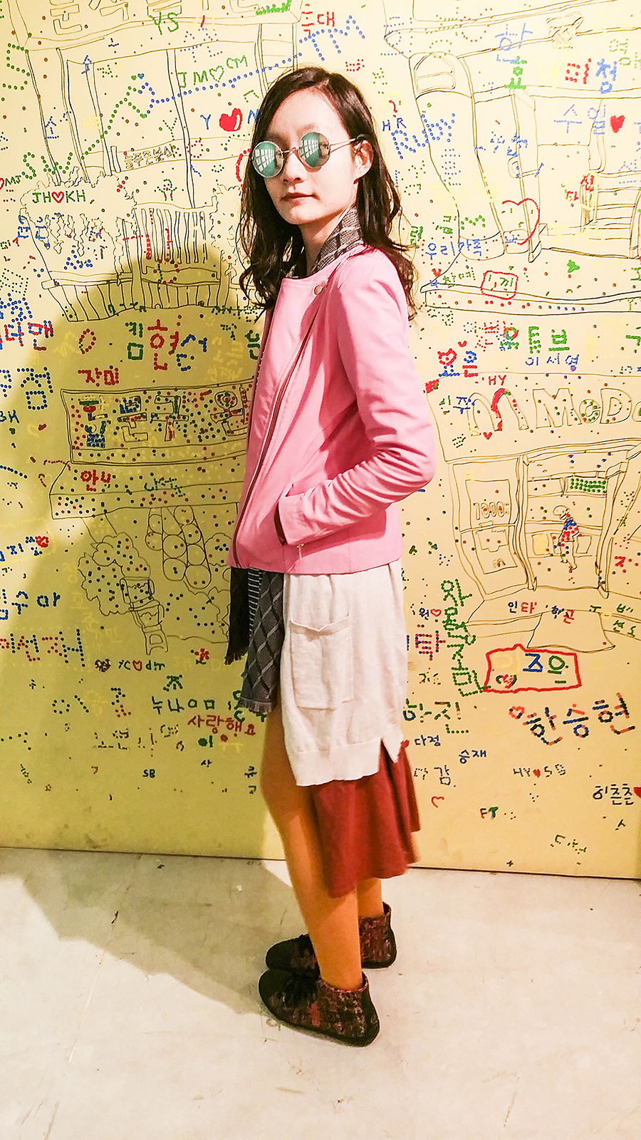 Outfit photo at Seoul Comics Space Zaemirang at Zaemiro Seoul Comics Road, South Korea. Featuring pink leather jacket from Viparo, striped dress and oversized cardigan from Zara, mustard yellow tights from Uniqlo, McQ x Puma high top sneakers.