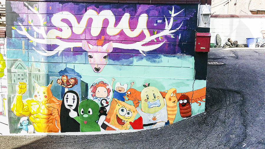 Pop culture mural featuring No Face (Spirited Away), Ponyo, Spongebob Squarepants, Adventure Time, Pikachu muscleman at Zaemiro Seoul Comics Road, South Korea.