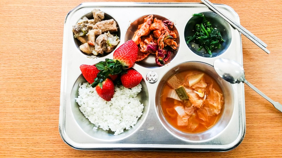School lunch at middle school in Sangju, South Korea: Kimchi, Strawberries.