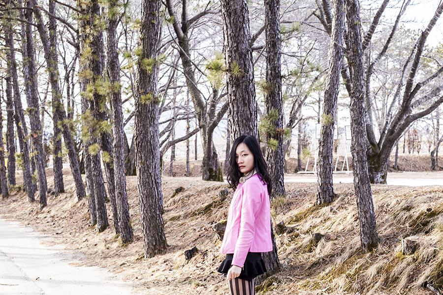 Outfit photo details: Viparo pink leather jacket, black skort from Terminal 21 Bangkok, Nordstrom black striped tights.
