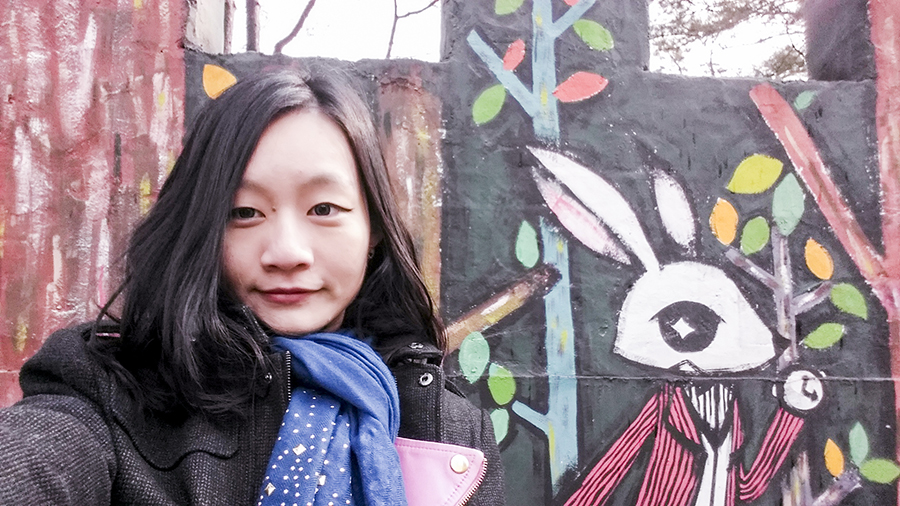 Selfie with cute bunny on the walls of a castle structure at Nami Island, Gapyeong, South Korea.