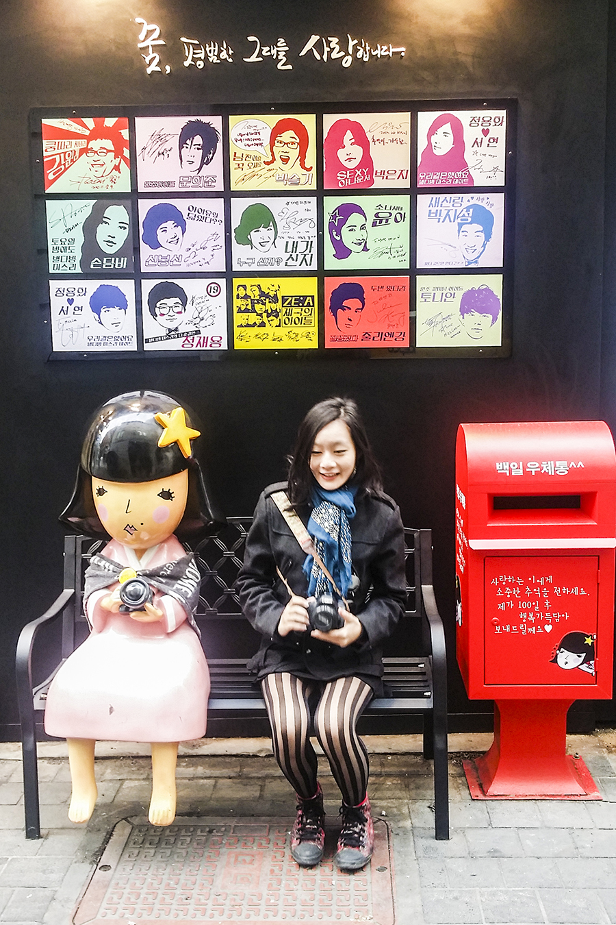 Taking a portrait with a cute statue outside Miss Lee Cafe in Myeongdong, Seoul, South Korea.