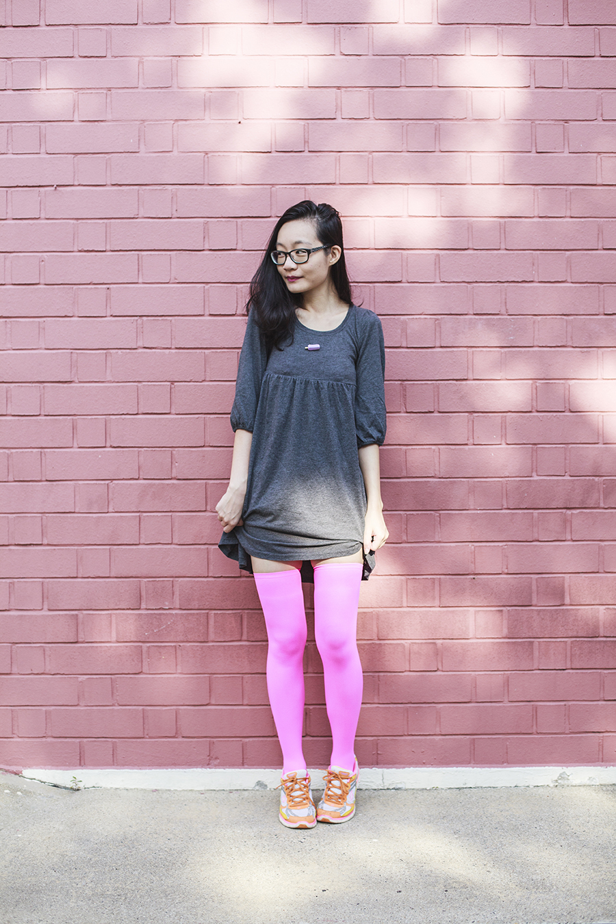 We Love Colors Outfit: We Love Colors neon pink thigh high stockings, Skechers neon sneakers, Forever 21 grey babydoll dress,  old school potong ice cream pin, Gap black rimmed glasses.