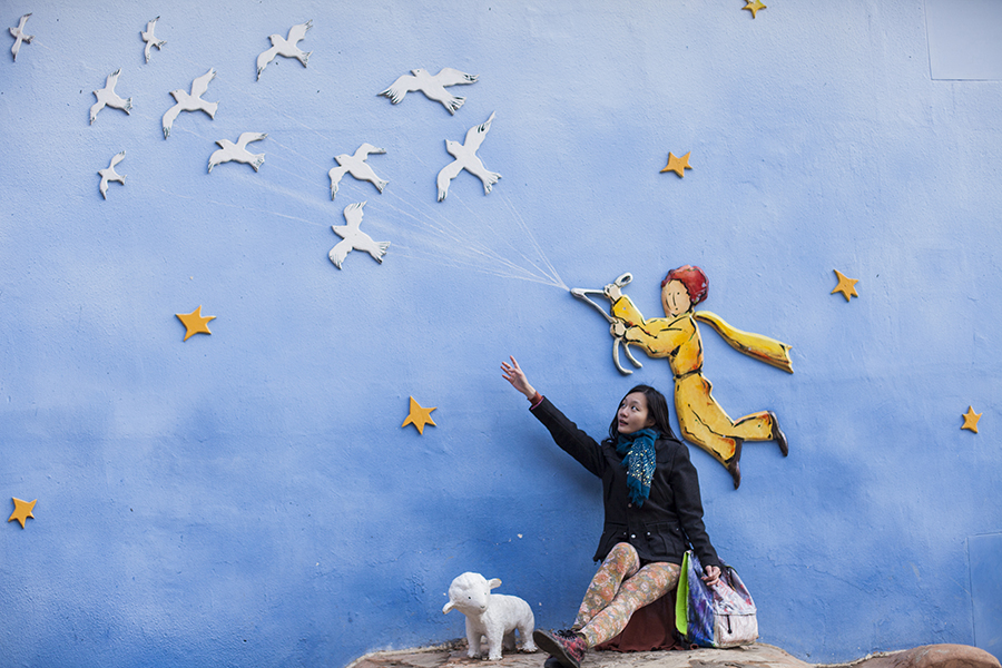 Ren posing against a 3d mural of the little prince flying off at Le Petit France, Gapyeong, South Korea.