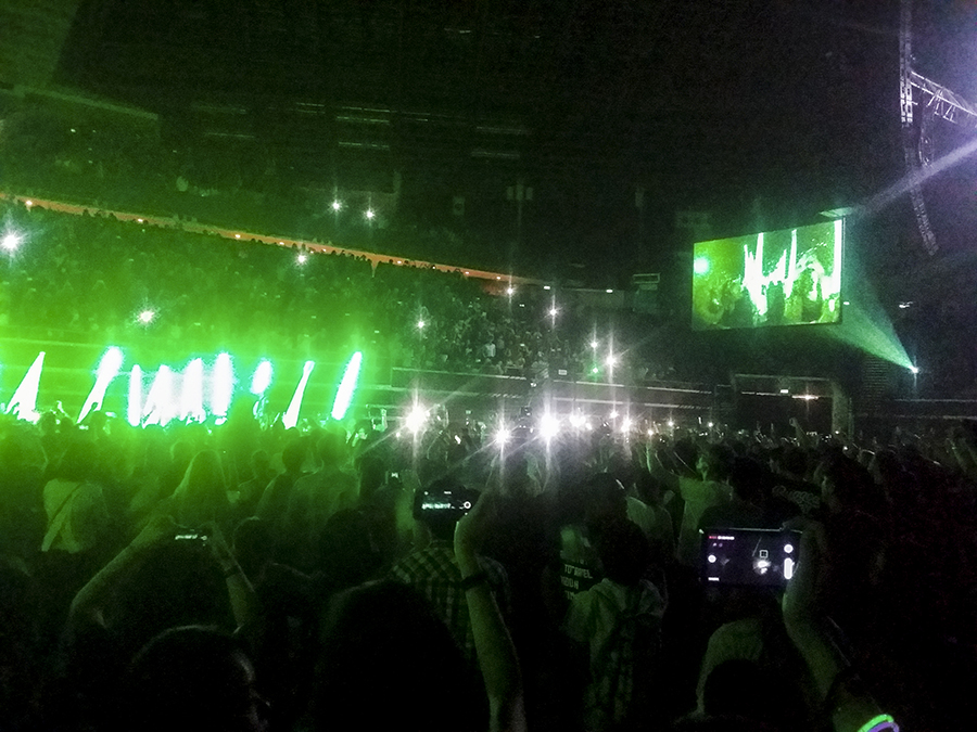 The Script entering the stage with green flare lights.