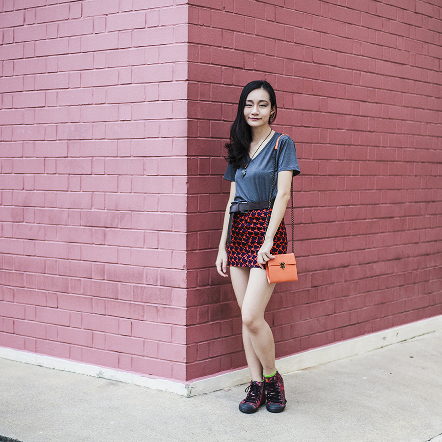 Airism v-neck grey top, red and blue skirt from Korea, Natural History Museum agate necklace, vintage gold earrings, Steve Madden orange sling bag, Alexander McQueen red sneakers.