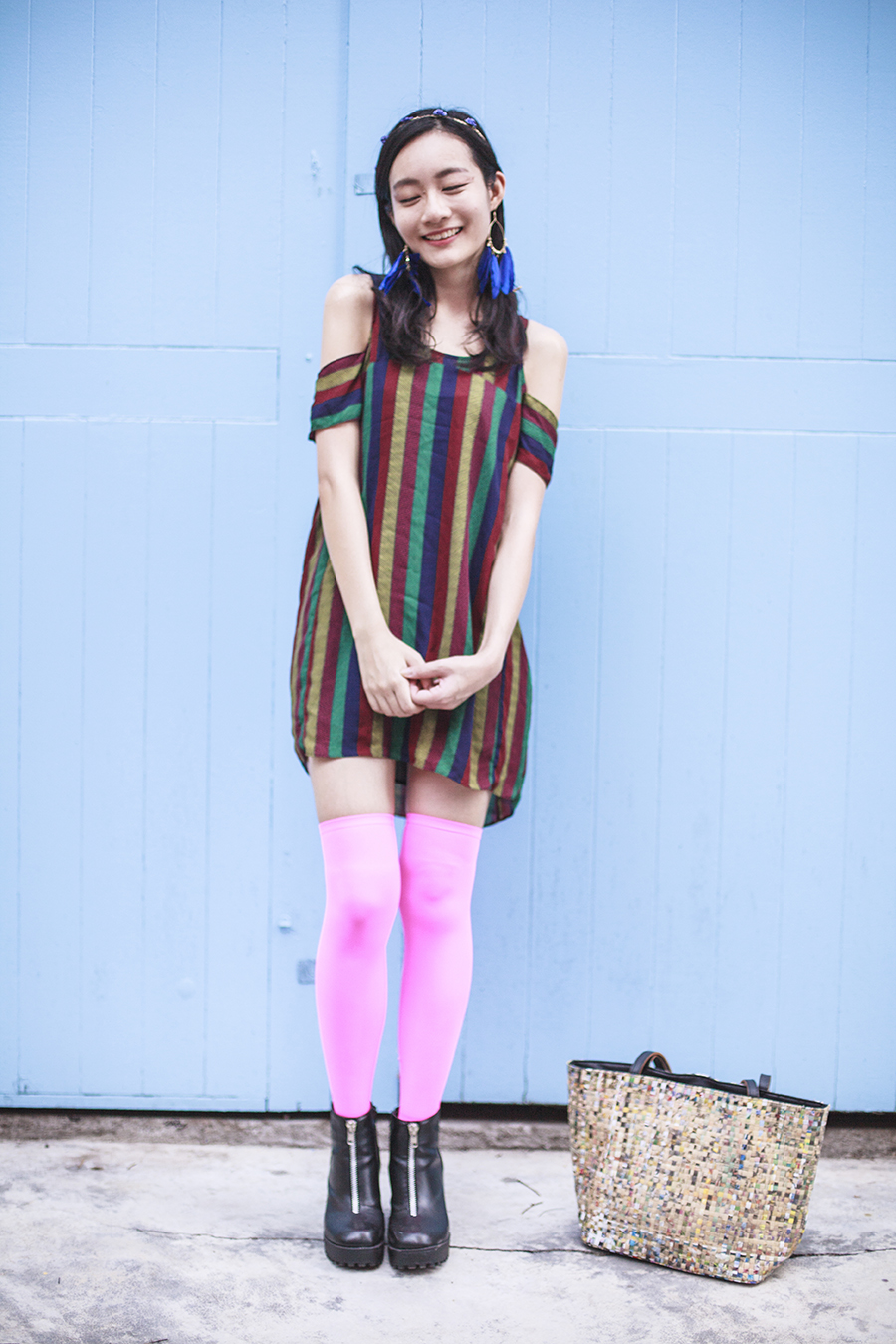 Bohemian Rhapsody Outfit: Urban Outfitters striped off-shoulder dress, We Love Colors neon pink thigh high stockings, Rubi black platform zipper boots, paper floral headband from Bangkok, H&M blue feather hoop earrings, manga strips tote bag from Hong Kong.