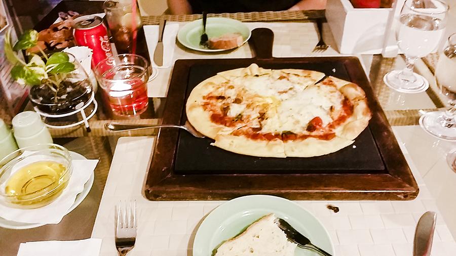 Thin crust wood-fired pizza at Harris Waterfront Resort, Batam, Indonesia.