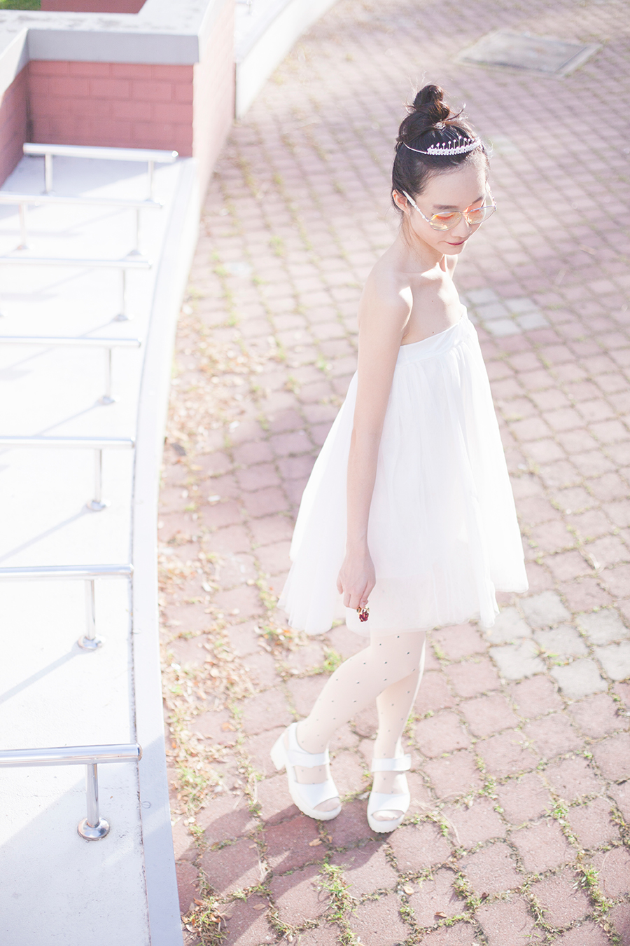 Princess outfit: Irresistible Me silver Aurora Tiara hair accessory, DressLink white tulle tutu skirt, Sunmill heart print tights from Shanghai, Taobao white platform sandals, Guess iridescent sunglasses.