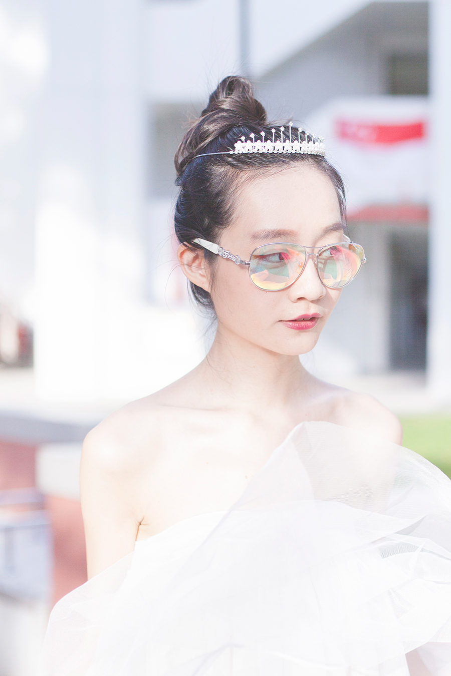 Princess outfit: Irresistible Me silver Aurora Tiara hair accessory, DressLink white tulle tutu skirt, Guess iridescent sunglasses.