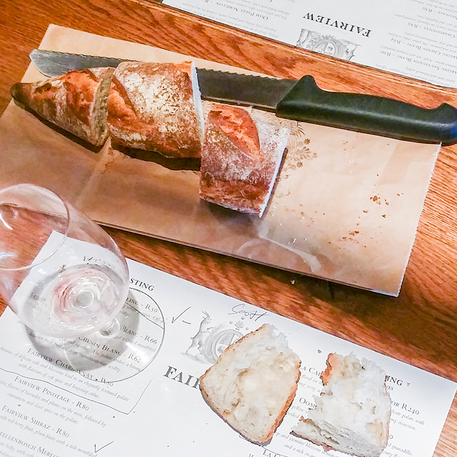 Wine and bread at the wine tasting at Fairview Wine and Cheese, South Africa.