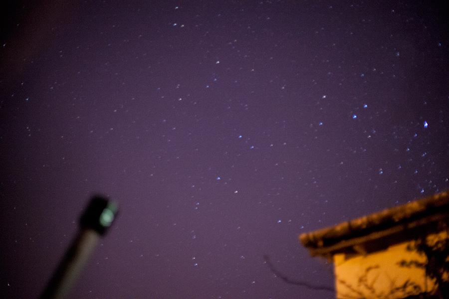 Enjoying the starlit night sky with a telescope during a braai.