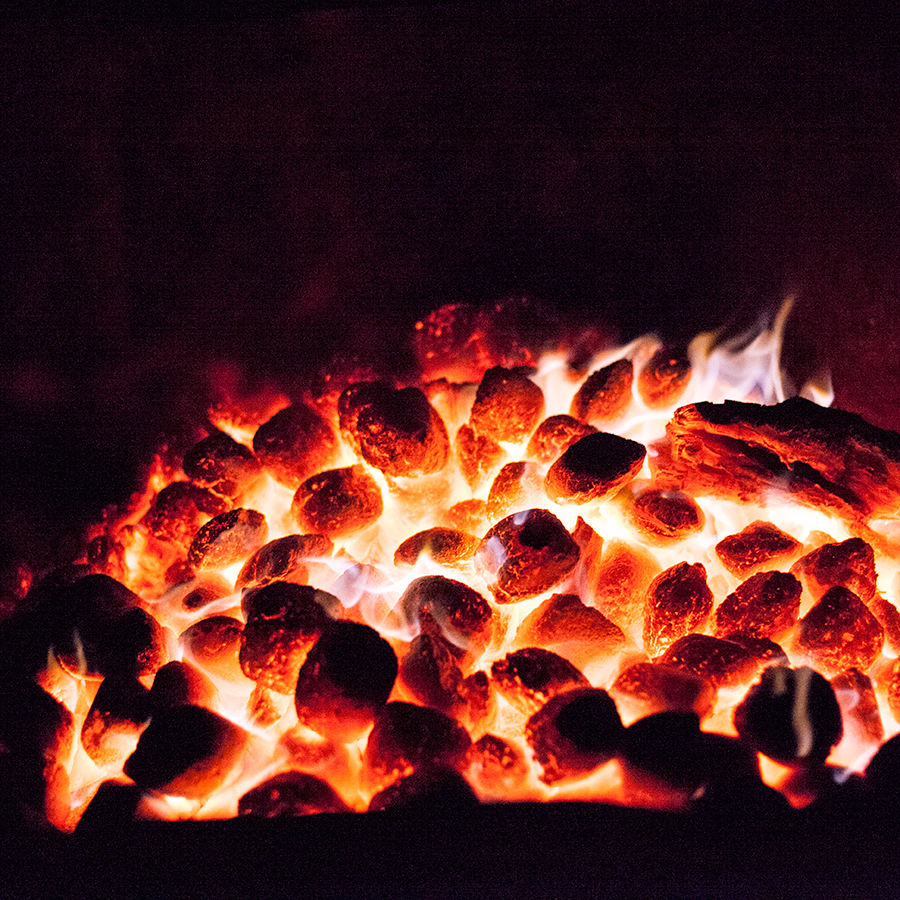 Burning coals on a braai.