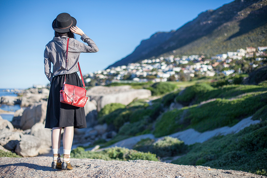 Outfit at Boulders Beach, Table Mountain National Park, Cape Town, South Africa: Dressgal grey linen shirt, Dressgal red satchel handbag, 24:01 black round sunglasses, Taobao black felt hat, Lowry's Farm black midi skirt with pockets, Anonymous Ism patchwork crew socks via Shopbop, Something Borrowed black & gold pointed flats via Zalora.
