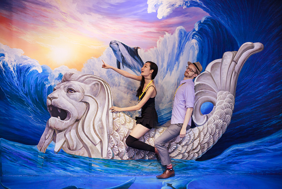 Ren and Ottie going on an adventure at the Merlion trompe-l'œil at the Trick Eye Museum Renewal Event in Singapore, Resorts World Sentosa.