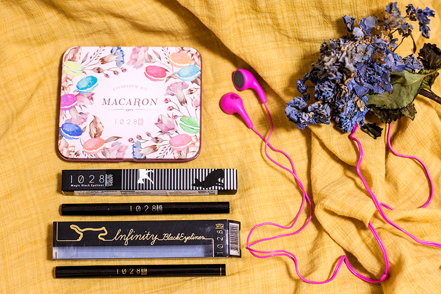 1028 macaron eyeshadow palette, 1028 black eyeliner, iLuv hot pink earphones.